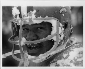 Close up of football player with helmet on. Helmet is covered with snow on the edges.