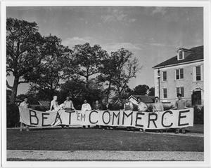 [Students with Homecoming banner, 1941]