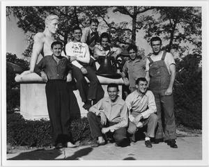 "Primary view of object titled '[Students posing with ""The Student"" sculpture]'."