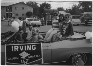 [Photo of North Texas Alumni in a Parade, 1989]
