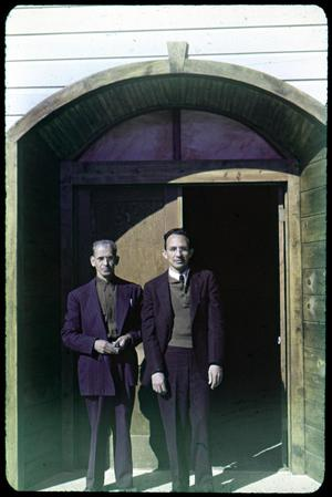 Primary view of object titled '[Two Men Standing in Entryway of El Buen Pastor Church]'.