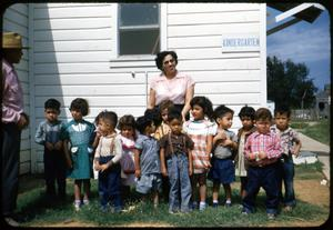 Primary view of object titled '[Photograph of Children Outside El Buen Pastor Church]'.