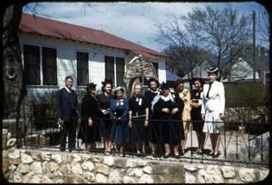 Primary view of object titled '[Photograph of Women in Courtyard of Presbyterian Center]'.