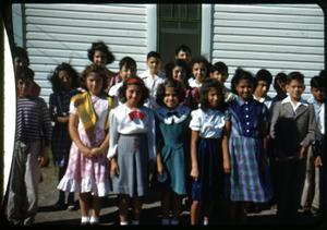 Primary view of object titled '[Photograph of Children in Front of a White Building]'.