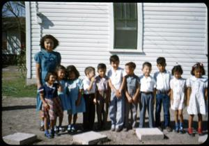 Primary view of object titled '[Photograph of Children in Front of White Building]'.