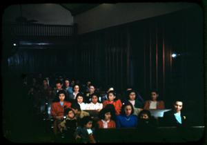 Photograph of People in Pews