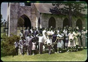Primary view of object titled '[Photograph of Group by Chapel at Mo-Ranch]'.
