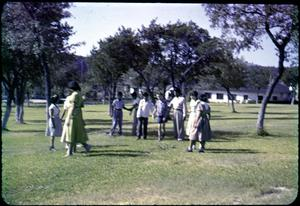 Primary view of object titled '[Photograph of Group Outside at Mo-Ranch]'.