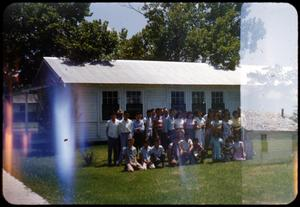 Primary view of object titled '[Photograph of Group by Church]'.