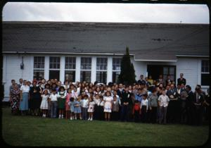 Primary view of object titled '[Photograph of Large Group in Front of White Building]'.