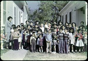 Primary view of object titled '[Photograph of Children Outside Iglesia Presbiteriana Mexicana]'.