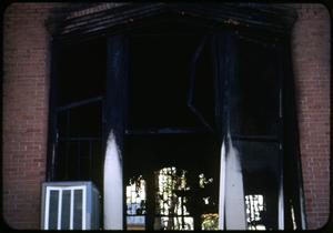 Primary view of object titled '[Photograph of Fire Damaged Window of Iglesia Presbiteriana Mexicana]'.