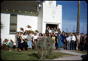 Primary view of object titled '[Photograph of People in Front of Iglesia Presbiteriana Mexicana]'.