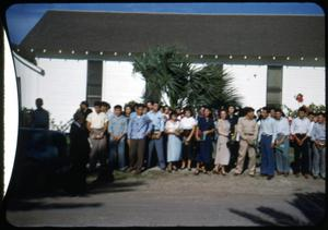 Primary view of object titled '[Photograph of Young People in Front of Iglesia Presbiteriana Mexicana]'.