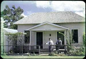 Primary view of object titled '[Photograph of Leos and Camacho in Front of Manse]'.
