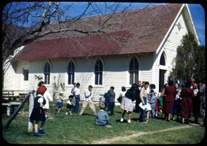 Primary view of object titled '[Photograph of Children Outside White Building]'.