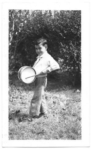 Primary view of object titled '[Boy Playing a Drum]'.