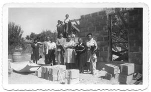 Primary view of object titled '[Group of People at a Construction Site]'.