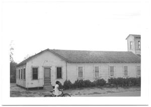 Primary view of object titled '[Girl on Bike in Front of Mexican Presbyterian Church]'.