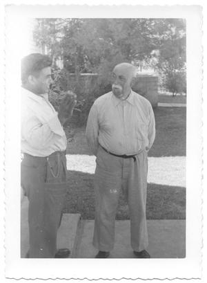 Primary view of object titled '[Two Men Visiting in Gonzales, Texas]'.