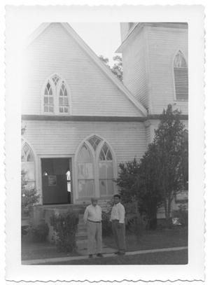 Primary view of object titled '[Two Men in Front of a Church in Gonzales, Texas]'.