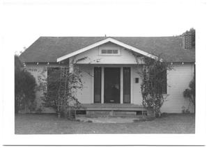 Primary view of object titled '[Front of Small House with Vines in Harlingen]'.