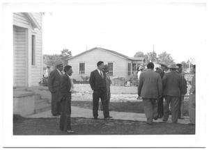 Primary view of object titled '[Men Visiting Outside of Church after Meeting]'.