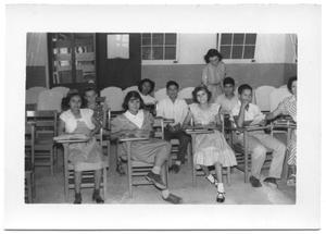 Children Sitting in Desks