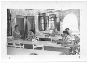 Primary view of object titled '[Group of Hispanic Women Working at Tables]'.