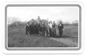 Primary view of object titled '[Group of Mexican Presbyterians with Church in the Background]'.