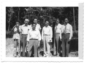 Primary view of object titled '[Group of Hispanic Men Standing in a Forest]'.