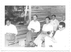 Primary view of object titled '[Class of Hispanic Men Sitting in a Log School House]'.