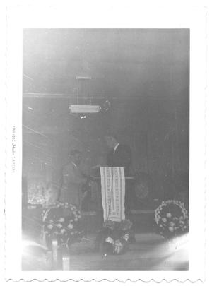 Primary view of object titled '[Two Men Standing at a Podium]'.