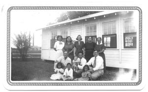 Primary view of object titled '[Group Posed in Front of a Presbyterian Building]'.