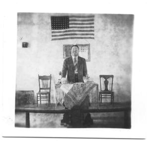 Primary view of object titled '[Man Standing Behind a Podium]'.