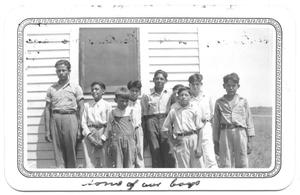 Primary view of object titled '[Group of Boys Standing in Front of a Window]'.