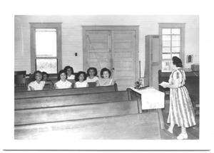 Group of Girls Sitting Together in Church Pews