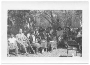 Primary view of object titled '[Group of Women Sitting on Chairs in the Shade]'.