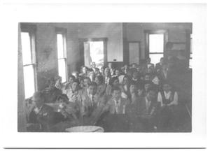 Primary view of object titled '[Large Congregation Sitting in Church Pews]'.