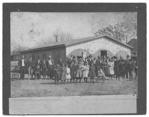 Primary view of object titled '[Large Congregation in Front of a Wood-Slatted Church]'.