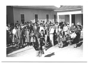 Primary view of object titled '[Hispanic Presbyterian Congregation Outside of a Church]'.