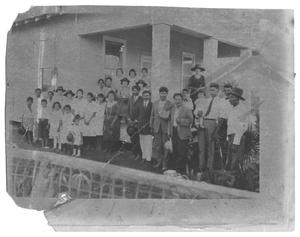 [Group Portrait on the Back Porch of a Building]