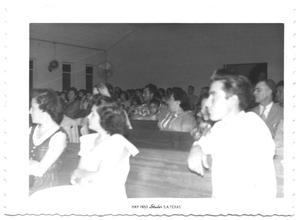 Large Congregation Sitting in Pews