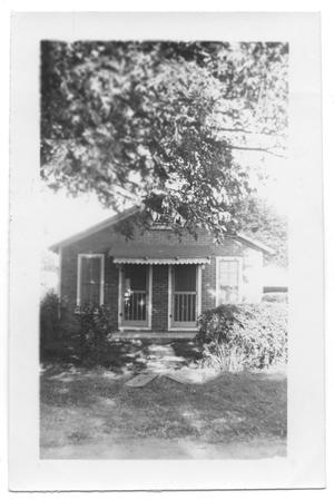 Primary view of object titled '[Small Brick House with Two Front Doors]'.
