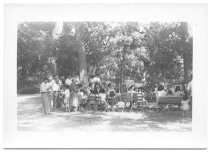 Primary view of object titled '[Congregation of People Gathered Around a Tree]'.