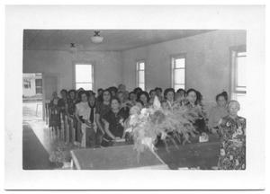 Women Sitting in Church Pews