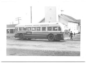 Primary view of object titled '[Bus Parallel Parked in Front of a Church]'.