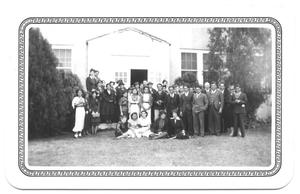 Primary view of object titled '[Large Group Portrait In Front of a Building]'.