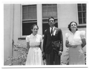 Primary view of object titled '[Three Hispanic Teenagers Standing in Front of a Building]'.
