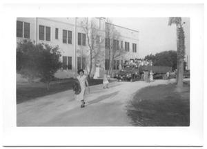 Primary view of object titled '[Hispanic Woman Walking Away From a School Building]'.